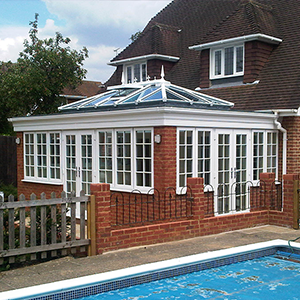 Large poolside orangery in pleasant garden